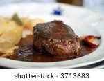 tenderloin steak Beef  on white plate with potatoes and plum sauce - stock photo