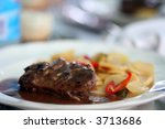 tenderloin beef steak on white plate with potatoes and plum sauce - stock photo