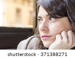 sad woman looking throw the... | Shutterstock . vector #371388271