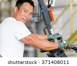 asian worker in production... | Shutterstock . vector #371408011
