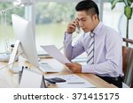 young businessman working with... | Shutterstock . vector #371415175
