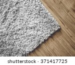 a carpet on parquet floor | Shutterstock . vector #371417725