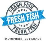 fresh fish blue round grunge... | Shutterstock .eps vector #371426479