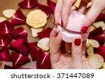 woman hands holding red box... | Shutterstock . vector #371447089