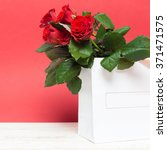 red rose and gift packages | Shutterstock . vector #371471575