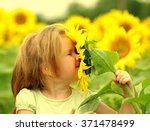 happy little girl smelling a... | Shutterstock . vector #371478499