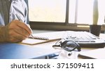 man working with documents. | Shutterstock . vector #371509411