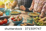 family having dinner together... | Shutterstock . vector #371509747