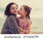 Cute Kid Girl Kissing Her Happ...