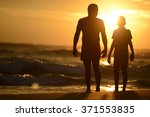 siluette of father and son... | Shutterstock . vector #371553835