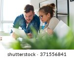 two young people looking at... | Shutterstock . vector #371556841