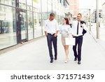 Business People Walking Trough...