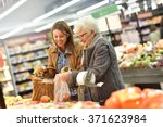 elderly woman with young woman... | Shutterstock . vector #371623984