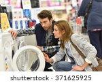 seller helping customer with...   Shutterstock . vector #371625925
