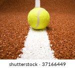 tennis ball on the court line | Shutterstock . vector #37166449