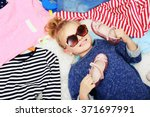 little girl and new clothes ... | Shutterstock . vector #371697991