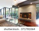 blazing fire in living room of... | Shutterstock . vector #371781064