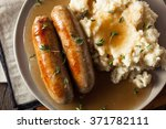 homemade bangers and mash with... | Shutterstock . vector #371782111
