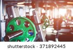 rod with weights in the gym | Shutterstock . vector #371892445