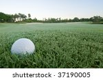 golf ball lies on dewy bunker in morning at florida course - stock photo