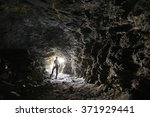 man explores a cave   Shutterstock . vector #371929441