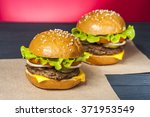 two appetizing hamburgers with... | Shutterstock . vector #371953549