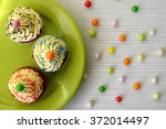 colorful cupcakes with cream ...   Shutterstock . vector #372014497