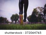 athletic woman running on park | Shutterstock . vector #372064765