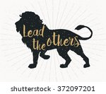 Stock vector lead the others dark grey lion silhouette on grey background 372097201