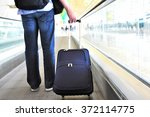 traveler with a suitcase on the ... | Shutterstock . vector #372114775