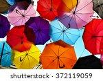 umbrellas falling from the sky | Shutterstock . vector #372119059