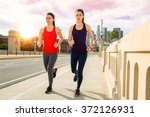 sunset downtown skyline women... | Shutterstock . vector #372126931