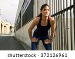 female jogger athlete rests to... | Shutterstock . vector #372126961