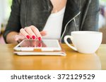 woman in the cafe drinking tea... | Shutterstock . vector #372129529