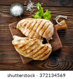 grilled chicken fillets on... | Shutterstock . vector #372134569