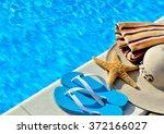 woman beach hat  bright towel... | Shutterstock . vector #372166027