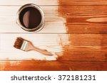 varnishing a wooden shelf | Shutterstock . vector #372181231