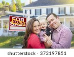 happy young family in front of... | Shutterstock . vector #372197851