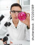 Scientist Examining Solution I...
