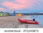 red lifeguard rescue boat on a... | Shutterstock . vector #372243871