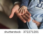 father holding baby hand | Shutterstock . vector #372271201