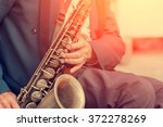 Saxophone In The Hands Of A...