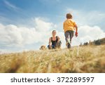 happy mother and son walk on... | Shutterstock . vector #372289597