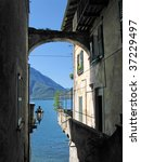 Romantic view to the famous Italian lake Como from Varenna town - stock photo