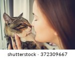 pets care.young woman holding... | Shutterstock . vector #372309667