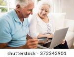 smiling senior couple using...   Shutterstock . vector #372342901