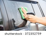 cleaning the car window with...   Shutterstock . vector #372352759