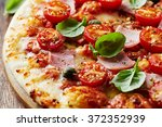 Pizza With Cherry Tomatoes And...