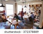 overhead view of businesspeople ... | Shutterstock . vector #372378889