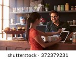 customer in coffee shop paying...   Shutterstock . vector #372379231